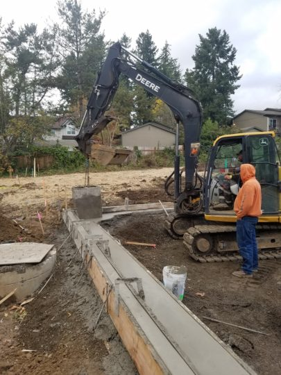 Hall-curbs being poured